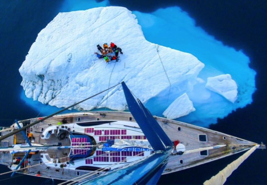sailboat with iceberg