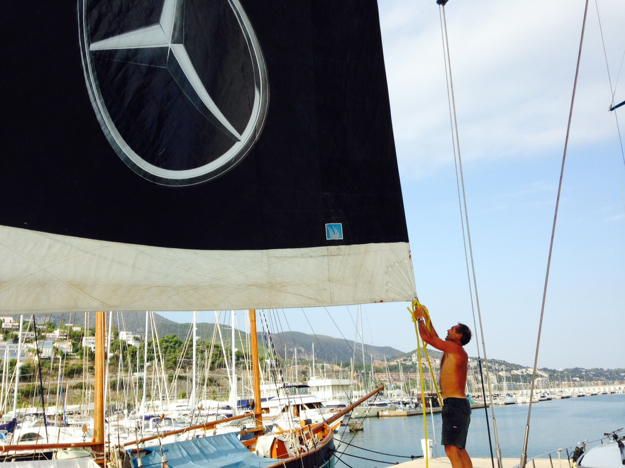 Mike controls Pangaea's sails in Barcelona